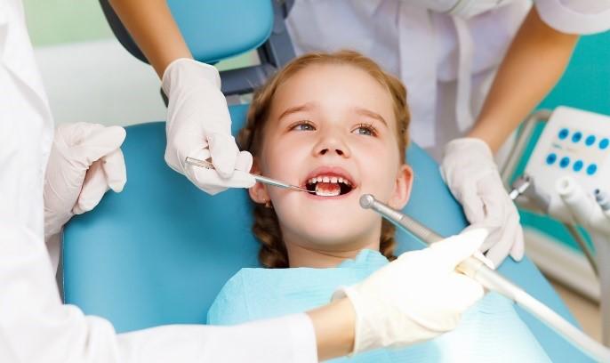 Лечение молочных зубов: фото